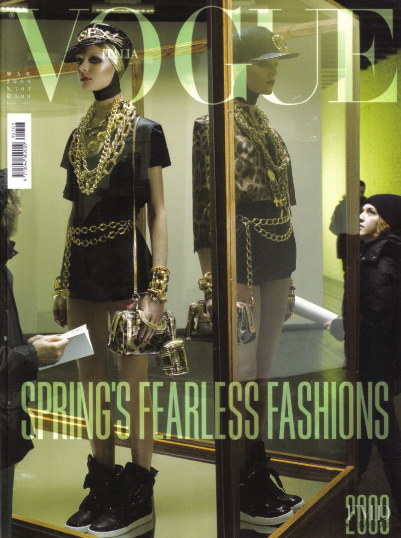 Kinga Rajzak featured on the Vogue Italy cover from March 2009
