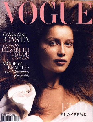Laetitia Casta featured on the Vogue Paris cover from September 2004