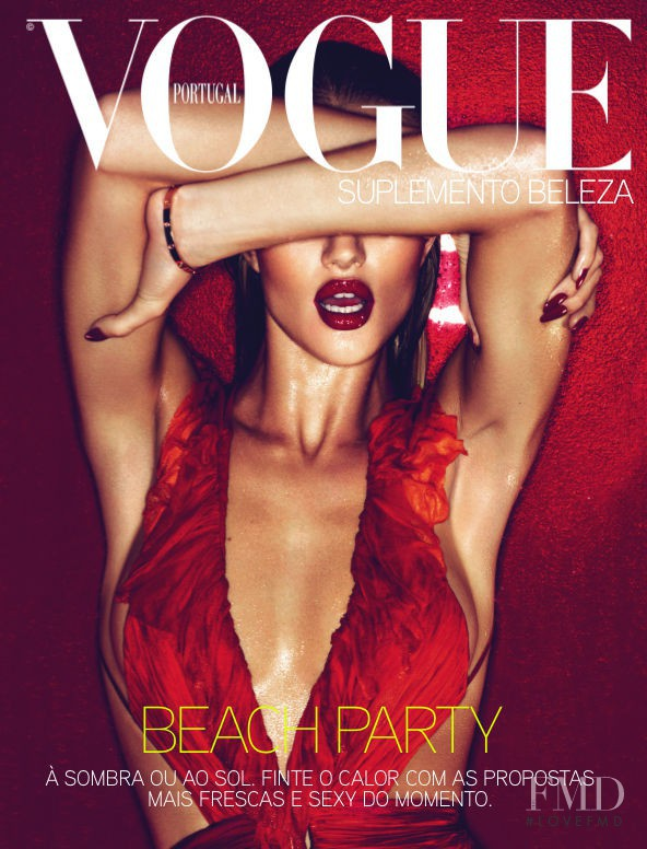 Rosie Huntington-Whiteley featured on the Vogue Portugal cover from May 2011