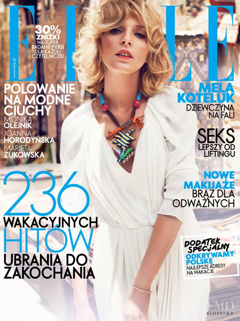 Mela Koteluk featured on the Elle Poland cover from August 2013
