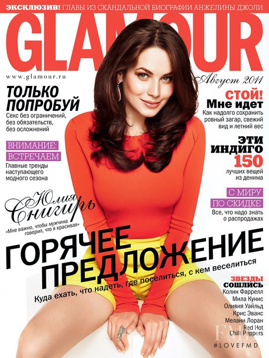 Julia Snigir featured on the Glamour Russia cover from August 2011
