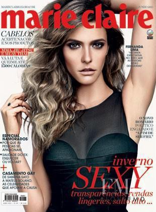 Fernanda Lima featured on the Marie Claire Brazil cover from June 2013