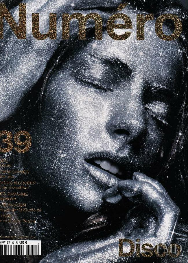 Jessica Miller featured on the Numéro France cover from December 2002