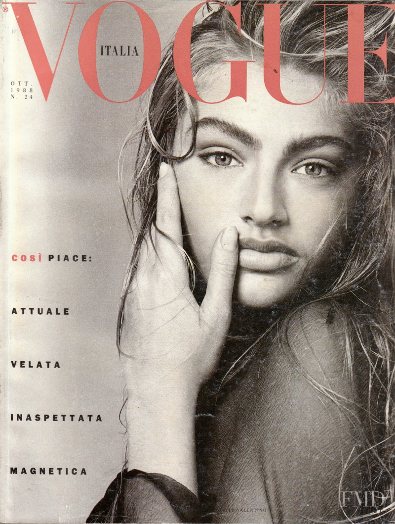 Michaela Bercu featured on the Vogue Italy cover from October 1988