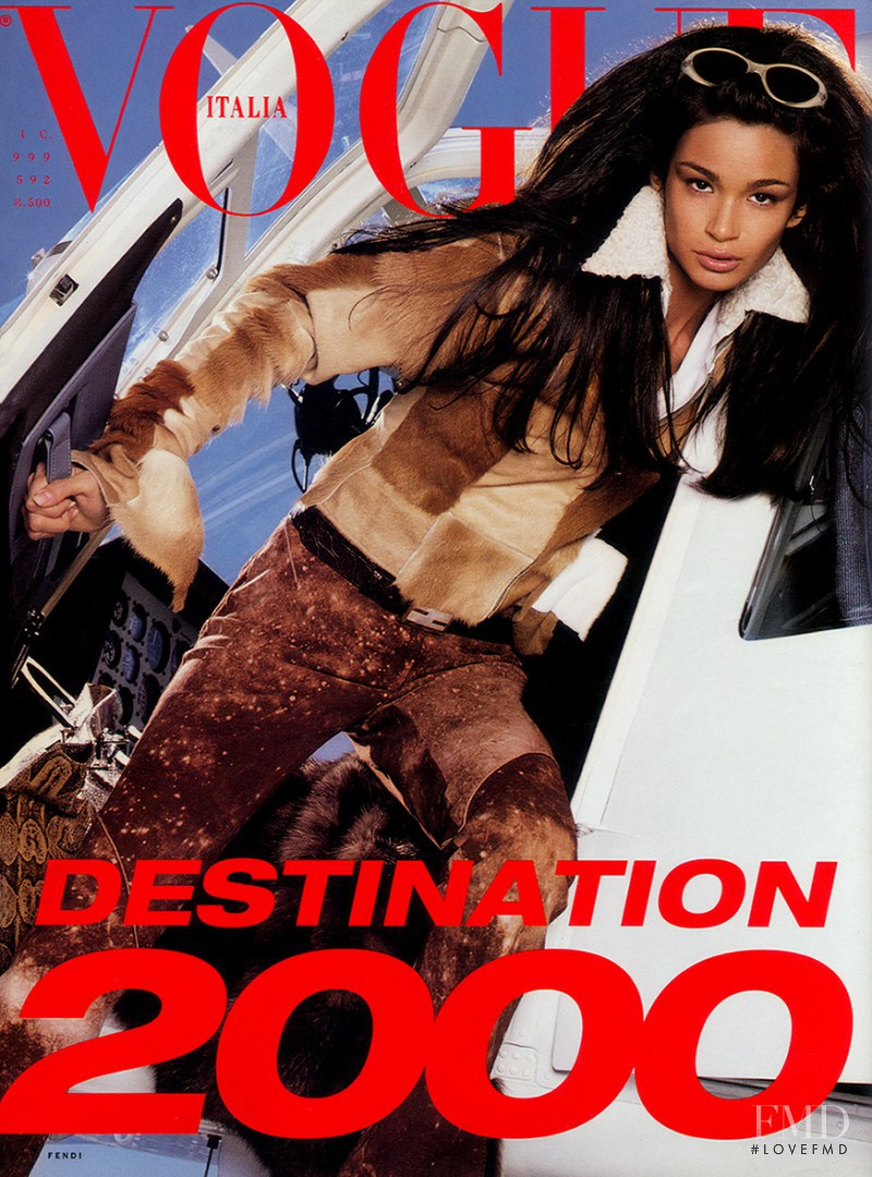 Caroline Ribeiro featured on the Vogue Italy cover from December 1999