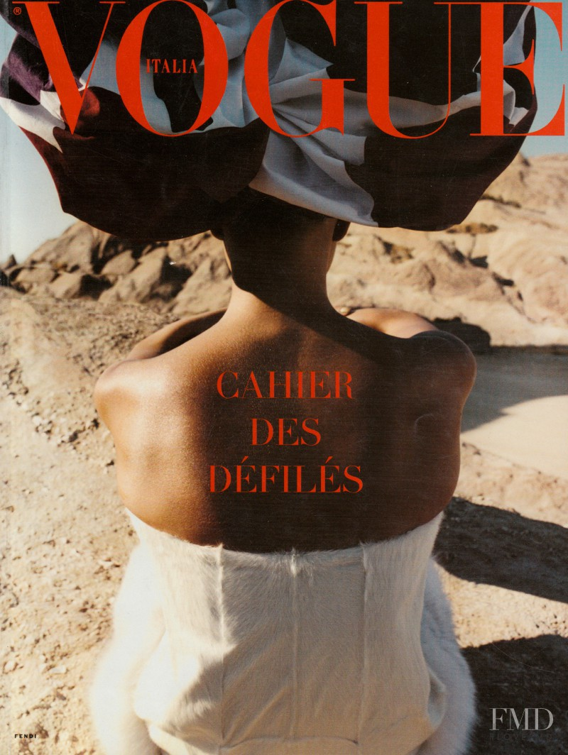 Karolina Kurkova featured on the Vogue Italy cover from July 2001
