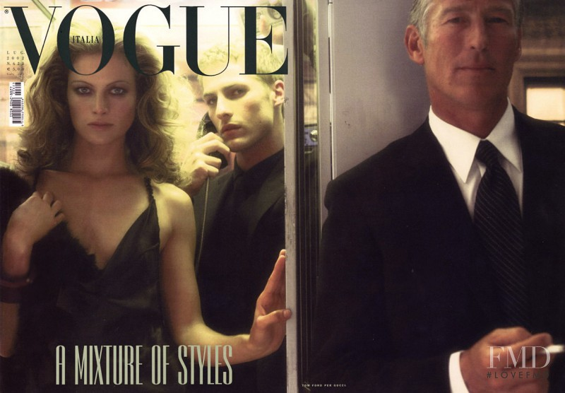 Carolyn Murphy featured on the Vogue Italy cover from July 2002