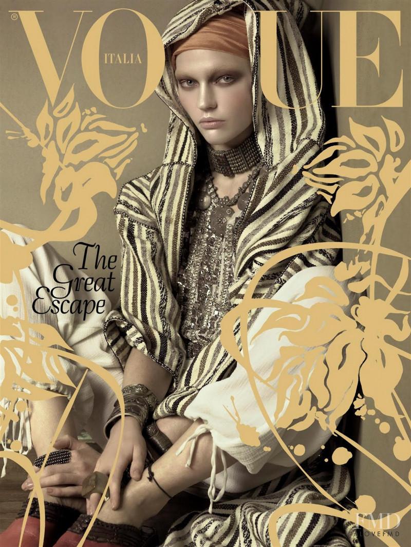 Sasha Pivovarova featured on the Vogue Italy cover from January 2009