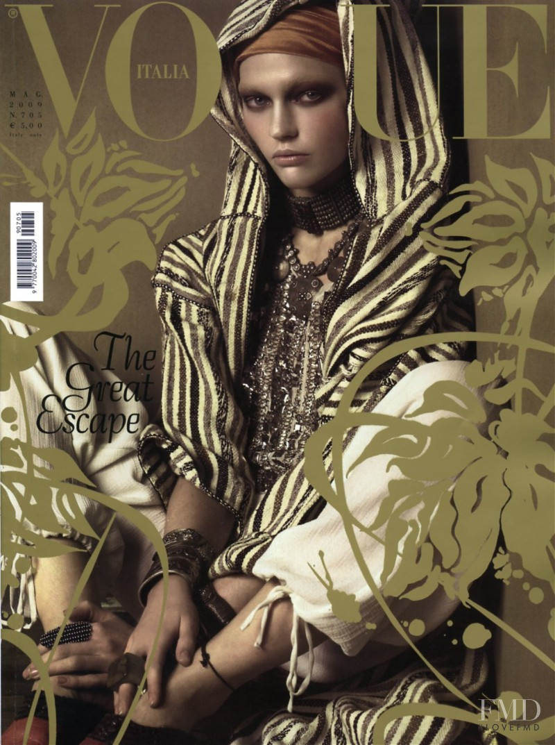 Sasha Pivovarova featured on the Vogue Italy cover from May 2009
