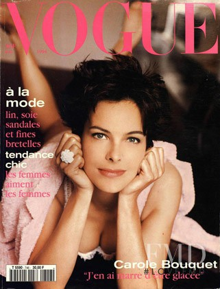 Carole Bouquet featured on the Vogue Paris cover from May 1994
