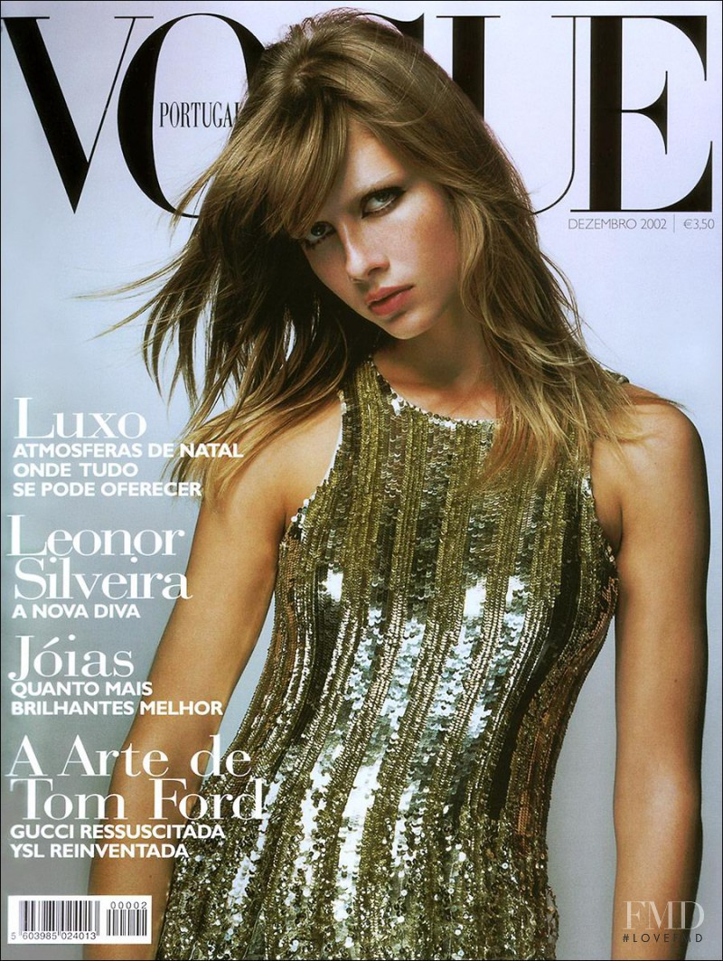 Ana Claudia Michels featured on the Vogue Portugal cover from December 2002