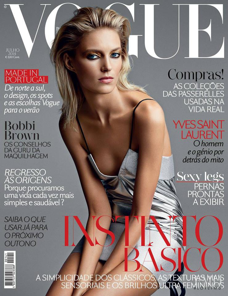 Anja Rubik featured on the Vogue Portugal cover from July 2014