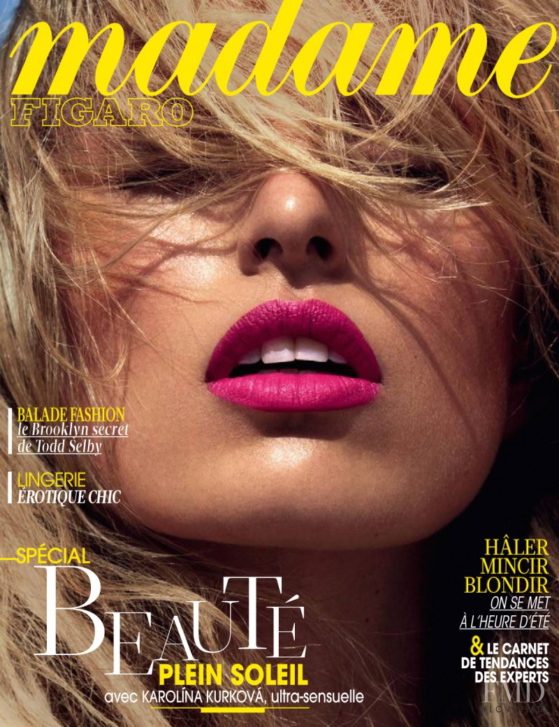 Karolina Kurkova featured on the Madame Figaro France cover from April 2014