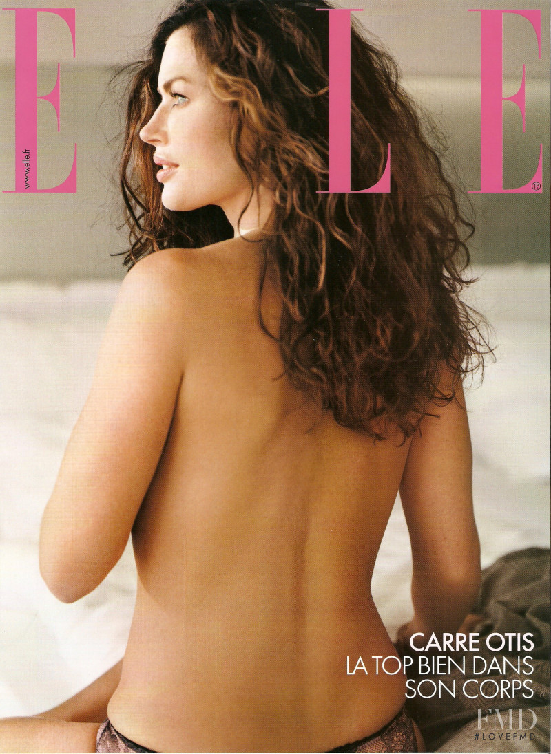 Carre Otis featured on the Elle France cover from December 2003