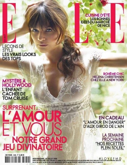 Helena Christensen featured on the Elle France cover from July 2006
