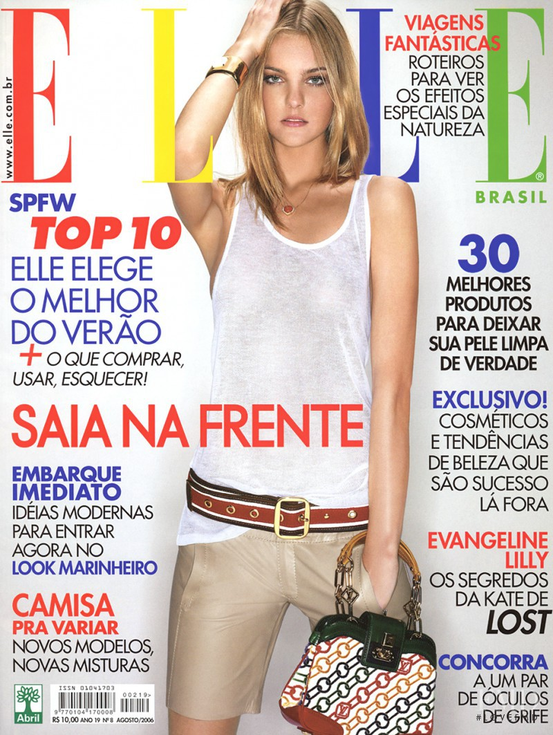Caroline Trentini featured on the Elle Brazil cover from August 2006