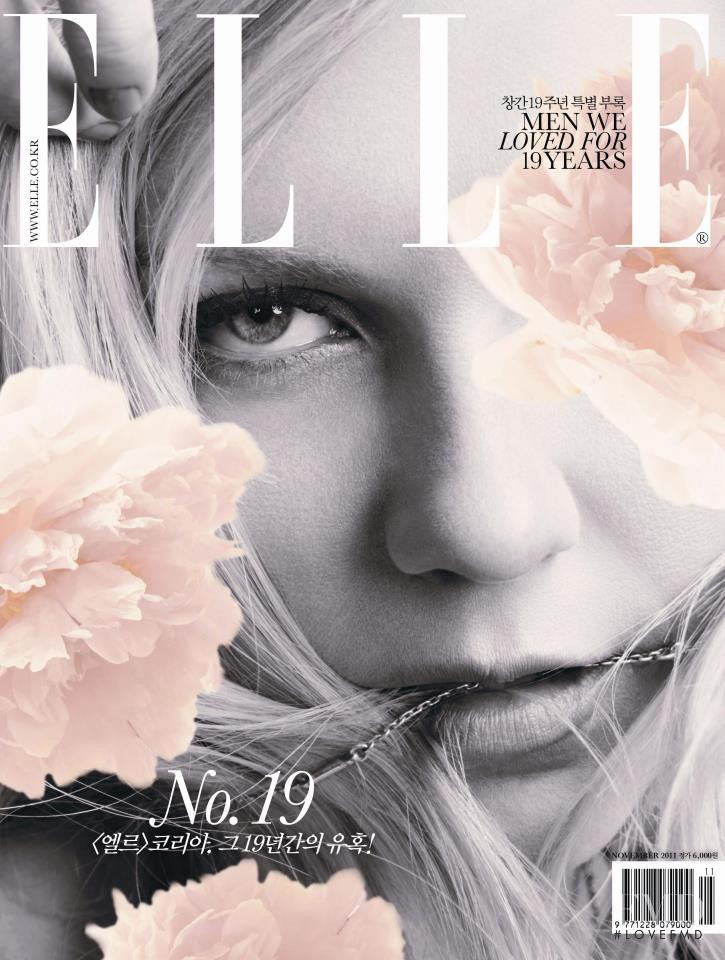 Kirsten Dunst featured on the Elle Korea cover from November 2011