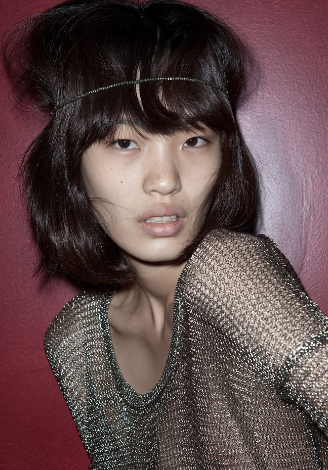 Chiharu Okunugi (New York Model Management) wearing MAC Lipstick in Sin, Estée Lauder Pure Color Powder Blush in Pink Ingenue, and Essie Nail Polish in Mambo. Photographed by Tom Newton.