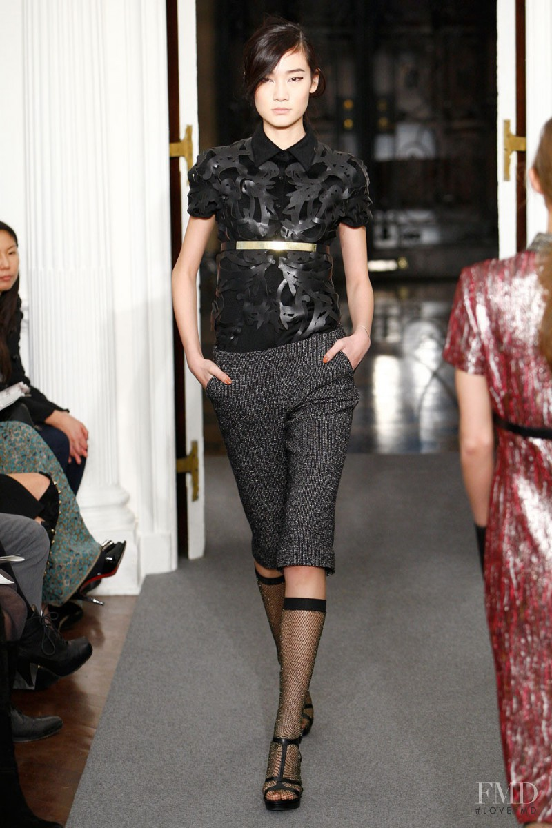 Jia Jing featured in  the Ports 1961 fashion show for Autumn/Winter 2011