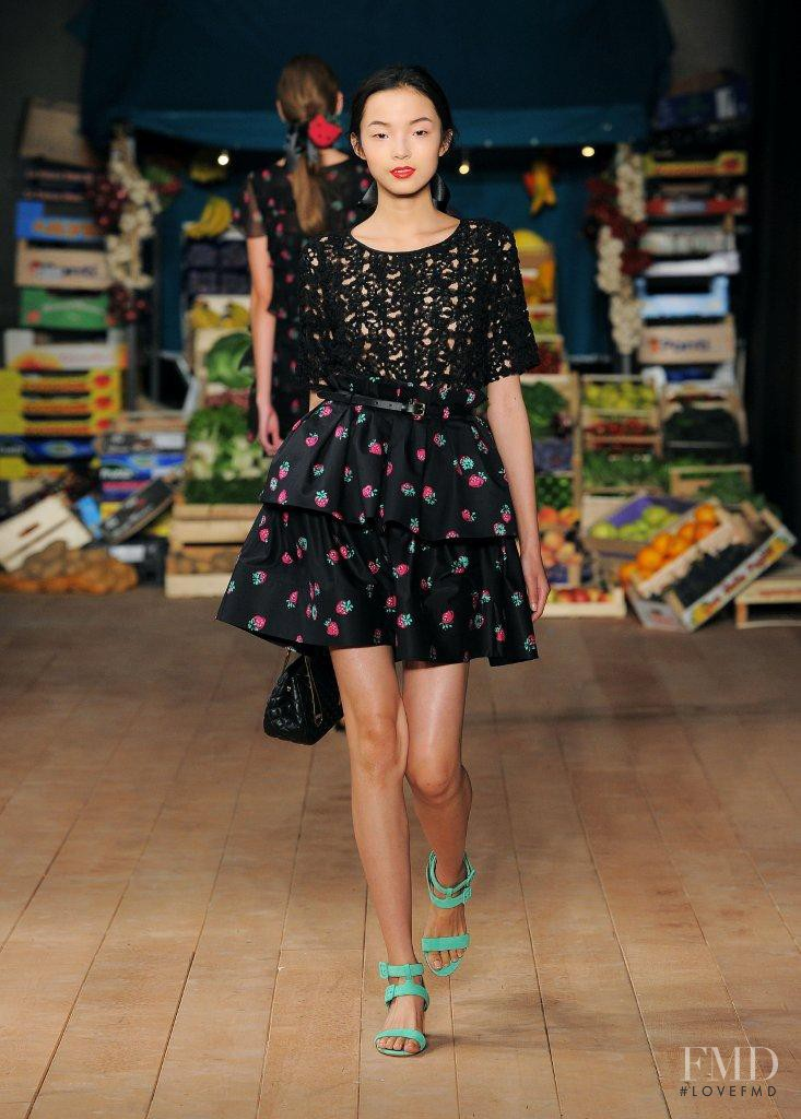 Xiao Wen Ju featured in  the Boutique Moschino fashion show for Spring/Summer 2012