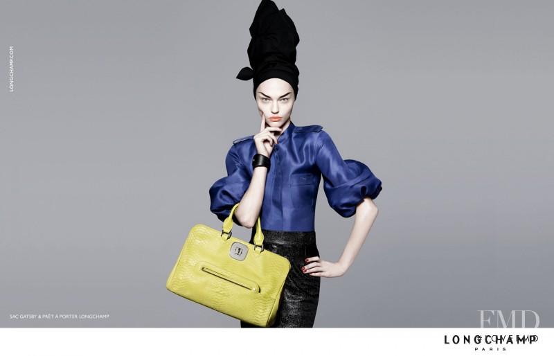Sasha Pivovarova featured in  the Longchamp advertisement for Spring/Summer 2010
